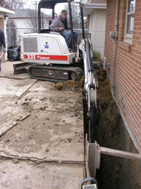 Excavating basement wall